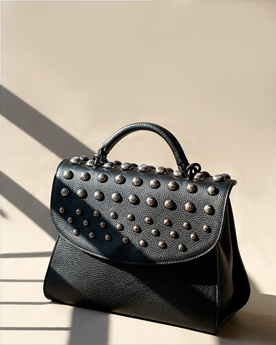 Kilesa black leather handbag with round studs