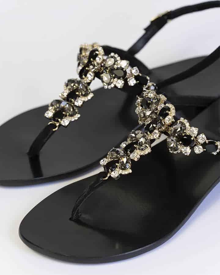 Kilesa black leather sandals with golden details